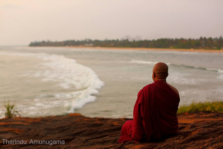 Tharindu monk meditating near the sea